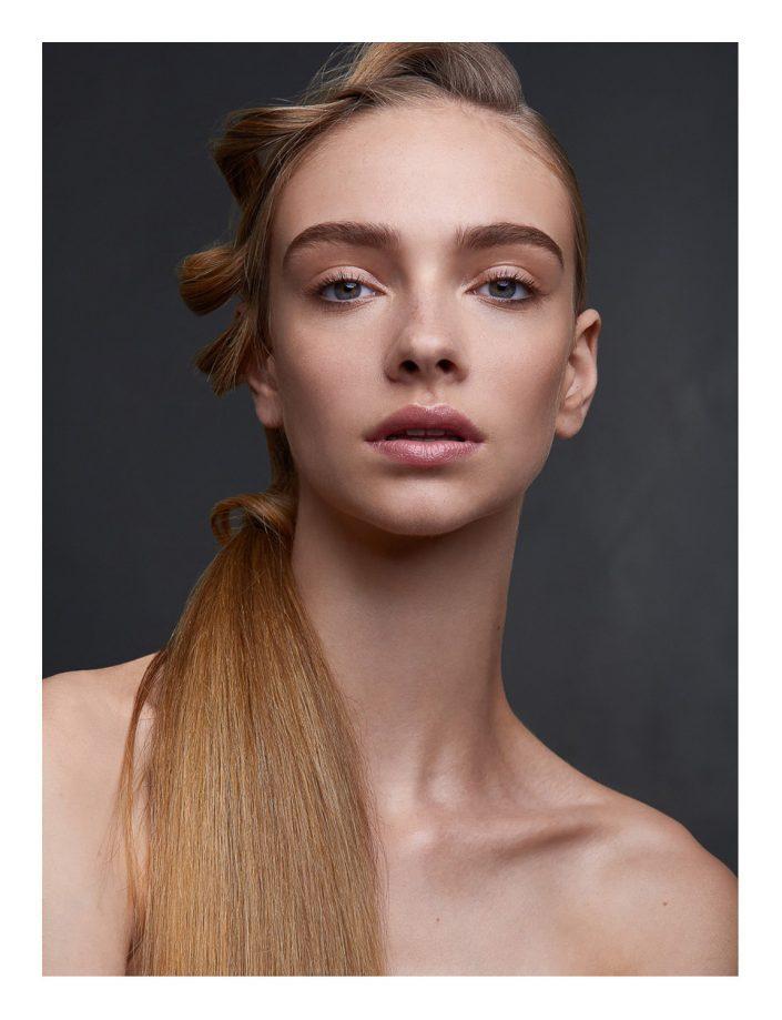 Blonde girl portrait in studio
