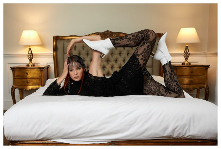 girl posing on the bed in hotel room