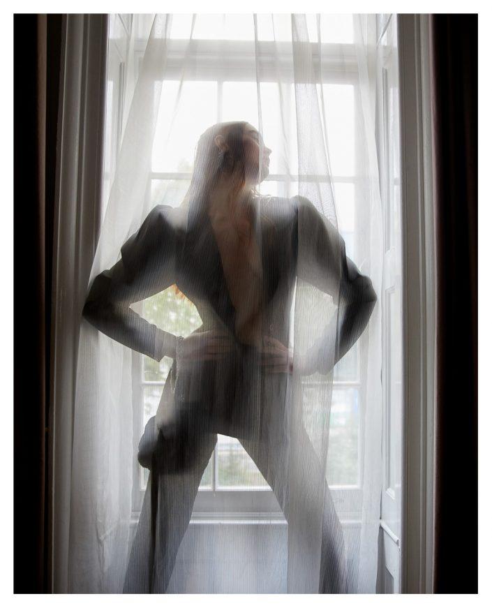 Ekin Can Bayrakdar Model Standing Lights Curtain London Indoor Ekin Can Bayrakdar - Fashion Photographer https://ekincanbayrakdar.com/