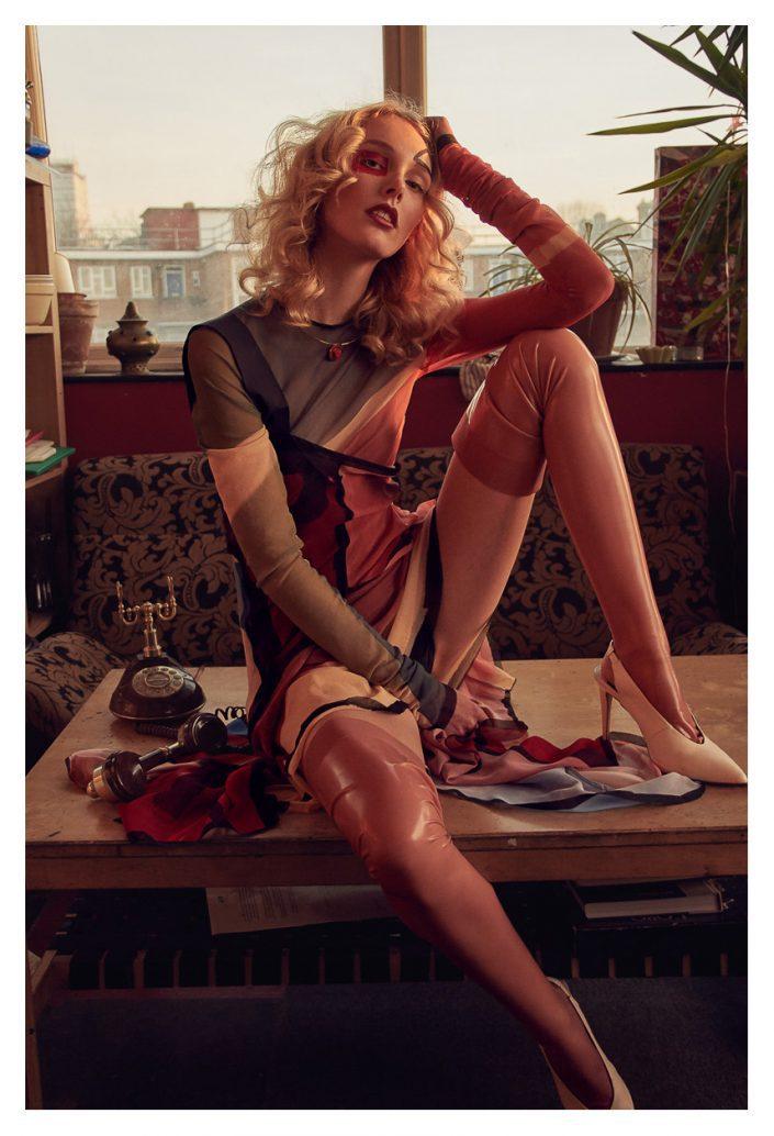 Ekin Can Bayrakdar Model sitting red Lingerie Blonde Model Editorial Ekin Can Bayrakdar - Fashion Photographer https://ekincanbayrakdar.com/
