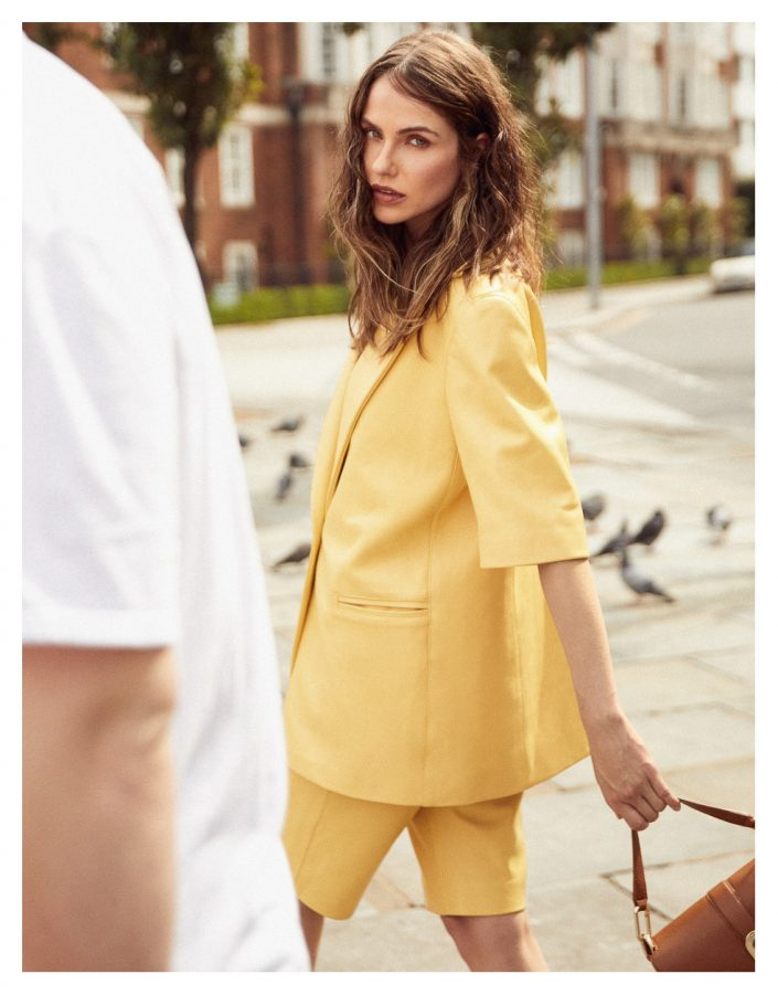 girl in yellow suit with purse