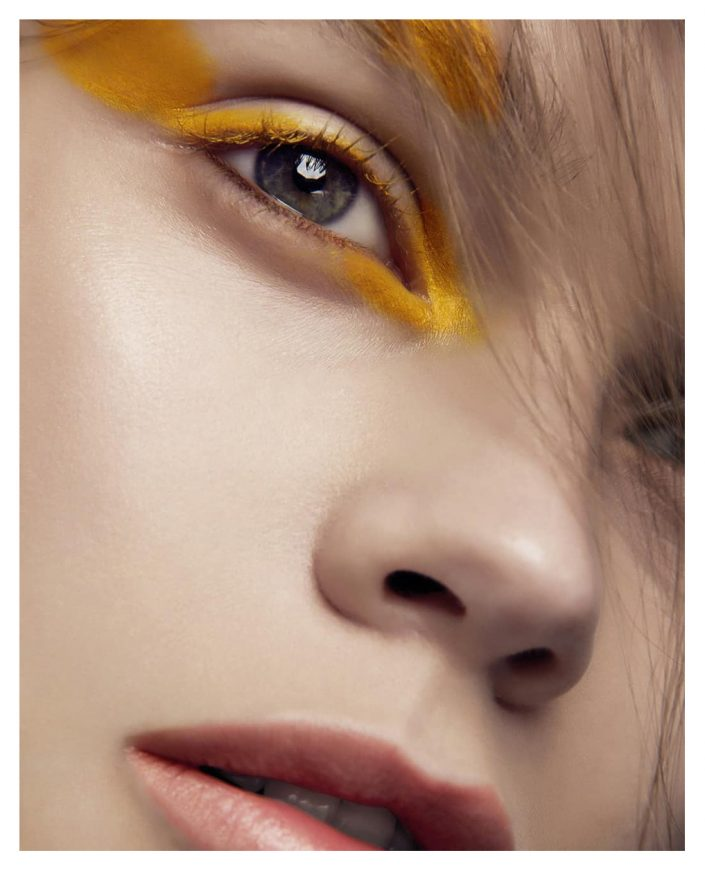 girl portrait with yellow make up beauty