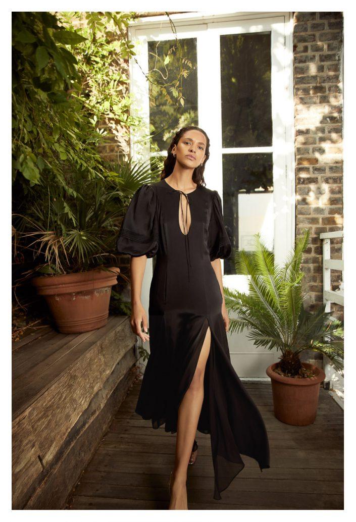 Model walking with black dress
